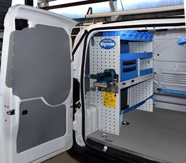 11_A pull-out vice bench in a van's left side racking